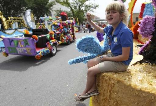 IDEA School's Sarah Johnston, 7, waves to fellow parade participants before the start of the 2014 Battle of Flowers parade on Friday, Apr. 25, 2014. (Kin Man Hui/San Antonio Express-News) Photo: Kin Man Hui, San Antonio Express-News