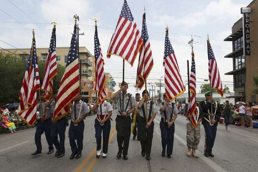 The 2014 Battle of Flowers parade vanguard consisting of local high school ROTC students kick off the parade on Friday, Apr. 25, 2014. (Kin Man Hui/San Antonio Express-News) Photo: Kin Man Hui, San Antonio Express-News