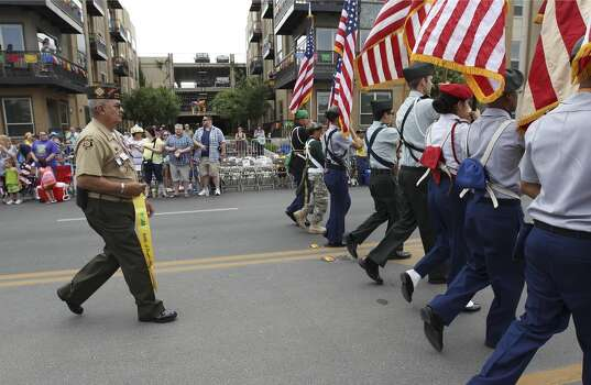 Retired U.S. Army Sgt. Lonnie Garza has participated in the 2014 Battle of Flowers parade vanguard for over 25 years on Friday, Apr. 25, 2014. (Kin Man Hui/San Antonio Express-News) Photo: Kin Man Hui, San Antonio Express-News