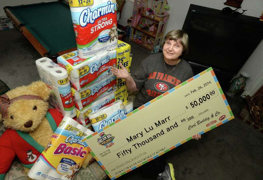 Mary Lu Marr, of Dublin, Calif., shows just a few of the items she has won playing hundreds of sweepstakes a day online at her home. Photo: Doug Duran, MBR / Contra Costa Times