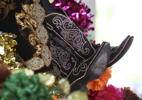 Princess of Vibrant Texas Heritage Sarah Virginia Brown sports a pair of sparkly boots for the 2014 Battle of Flowers parade on Friday, Apr. 25, 2014. (Kin Man Hui/San Antonio Express-News) Photo: Kin Man Hui, San Antonio Express-News