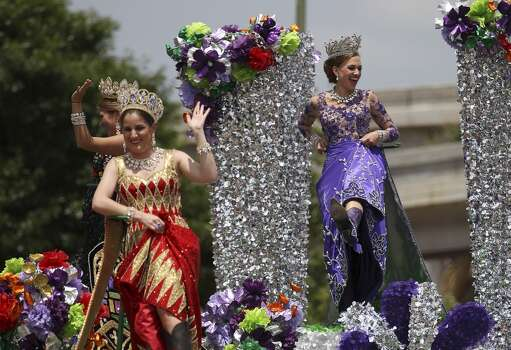 Duchess of the Mystique of Nature Avery Melissa Vaughan flashes her boots to the crowd at the 2014 Battle of Flowers parade on Friday, Apr. 25, 2014. (Kin Man Hui/San Antonio Express-News) Photo: Kin Man Hui, San Antonio Express-News
