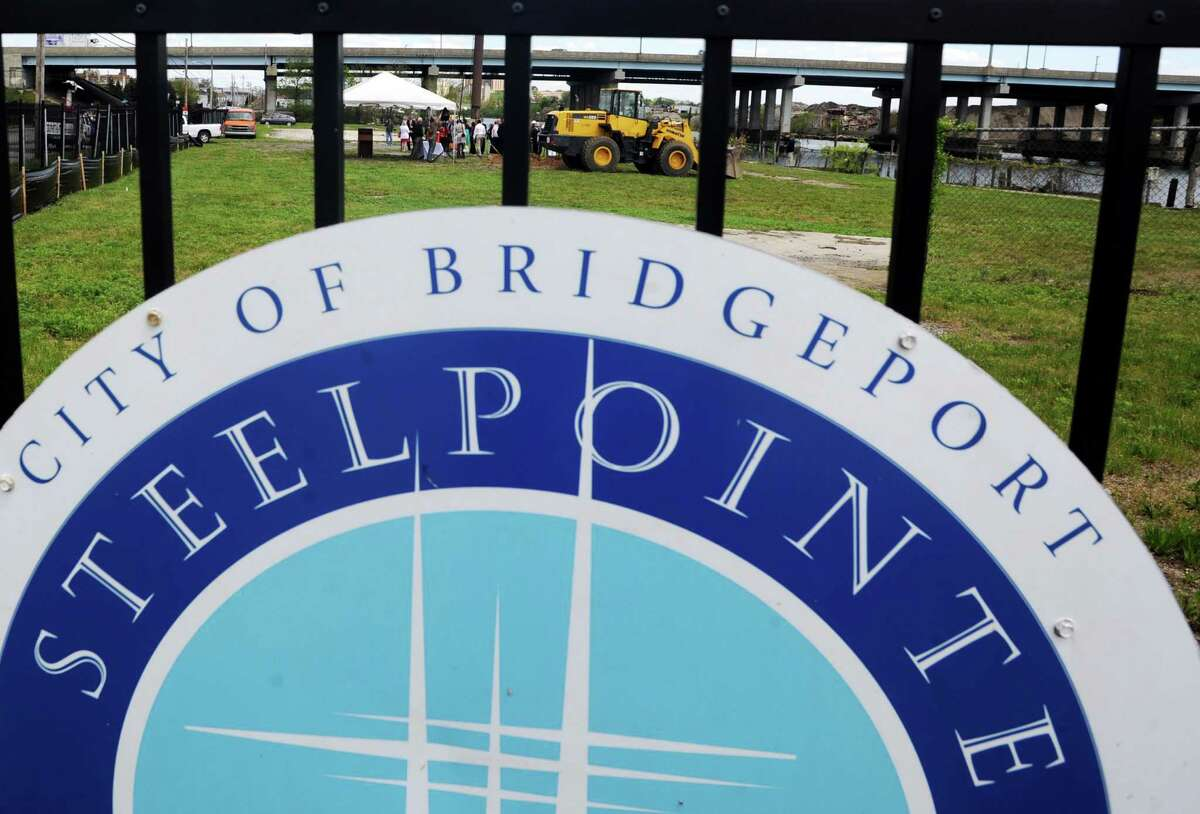 Mayor Bill Finch this week signed property-transfer documents to move forward with the long-awaited Steelpointe Harbor development project near Bridgeport's waterfront.
