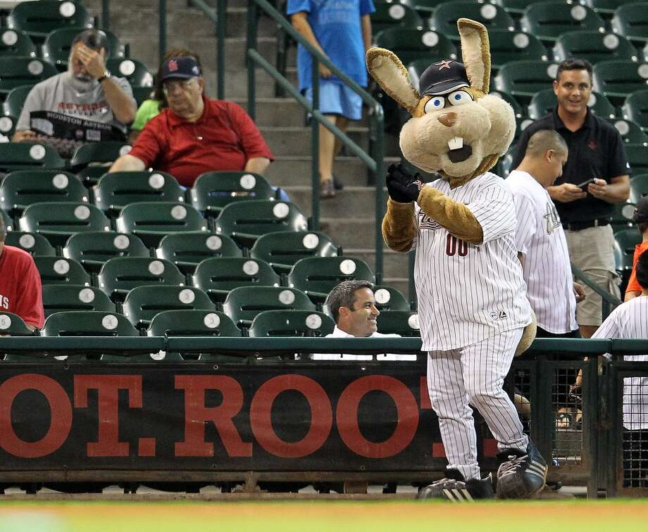 Junction Jack entertains fans before the start of an MLB baseball game at Minute Maid Park on Wednesday, Sept. 26, 2012, in Houston. He was replaced by the returning Orbit mascot two months later. Photo: Karen Warren, Houston Chronicle