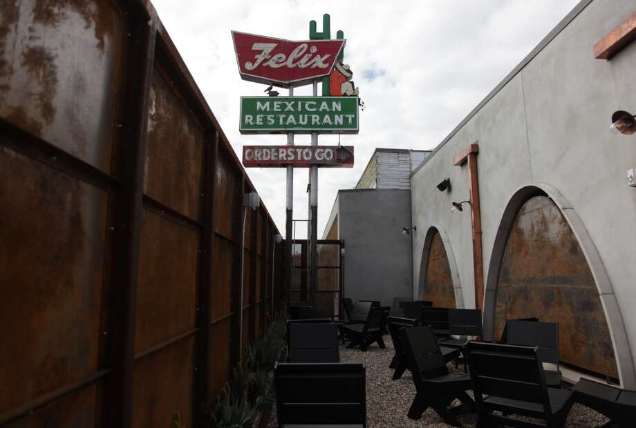 Felix Mexican Restaurant's sign is still in the patio area of Uchi Restaurant, even though not a drop of their legendary queso can be found. You can get something like it at El Real a few blocks away though. Photo: Mayra Beltran, Houston Chronicle
