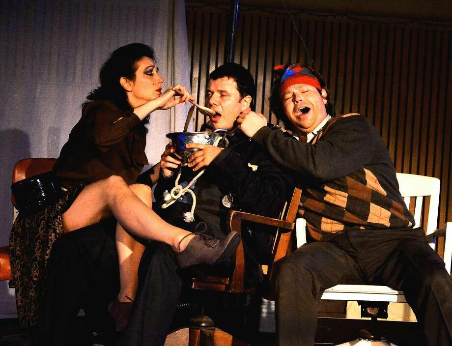 "Valentina Osinski (left), Eugene Brancoveanu and Christopher Bengochea in ""The Emperor of Atlantis,"" on Festival Opera's Holocaust-themed double bill. Photo: Richard Brundage"