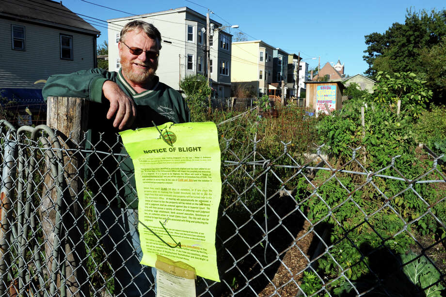 Bob Halstead stands in a community garden he has helped organize on an empty lot on Columbia Street, in Bridgeport, Conn. Oct. 11th, 2012. The City of Bridgeport has issued a citation stating that the property is blighted. Photo: Ned Gerard / Connecticut Post