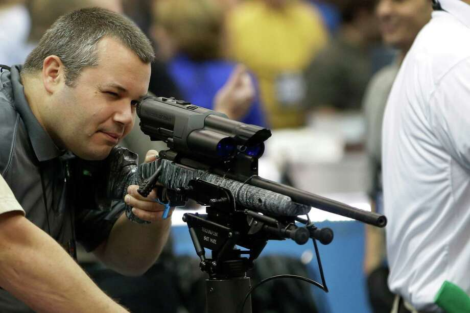 Mike Cisewski, of Maple Plain, Minn., and others at the National Rifle Association's annual convention Friday heard several potential Republican contenders for president court gun-rights supporters. Photo: AJ Mast, FRE / FR123854 AP