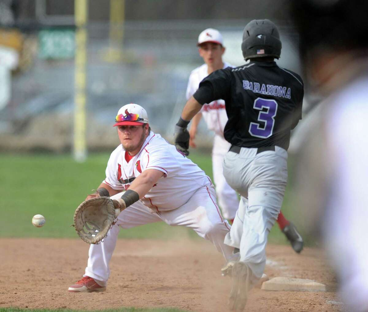 Greenwich first baseman Justin Gaccione, left, takes the throw for an out as Westhill's Randy Barahona (#3) is unable to beat out his bunt during the high school baseball game between Greenwich High School and Westhill High School at Greenwich, Friday afternoon, April 25, 2014.