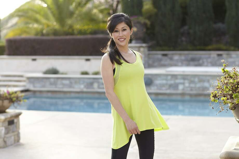 Former Olympic gold medalist Kristi Yamaguchi shows off apparel from the spring 2014 collection in Tsu.ya activewear line. Available at www.tsuyabrand.com. Photo: Ericka McConnell