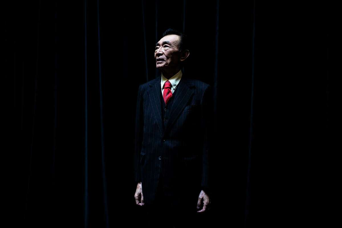 Master of ceremonies Yoshiomi Matsumoto poses for a portrait backstage.