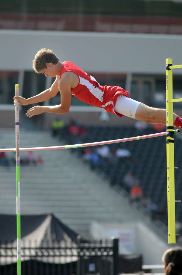 Bridge City sophomoe Ian Carruth clears the bar during the Boys Pole Vault competition at the 2014 Region III-3A Track & Field Championship at Turner Stadium in Humble on Friday. Photo: Jerry Baker, For The Chronicle