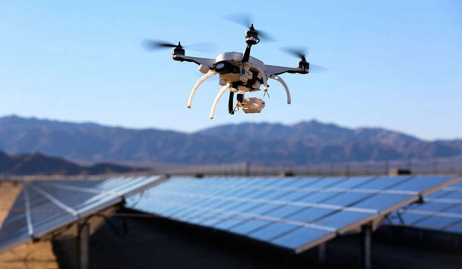 A Skycatch quadcopter can locate malfunctioning panels at solar power plants. Drones from Skycatch and other companies are also monitoring power lines, inspecting oil and gas pipelines and checking wind turbines for defects. Photo: New York Times / SKYCATCH
