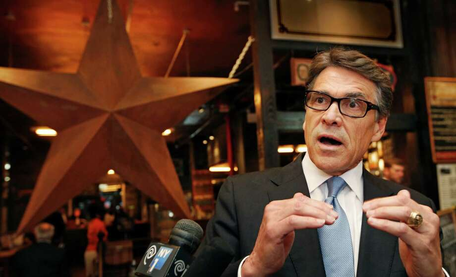 One of Texas Gov. Rick Perry's latest trips was to New York. Perry was trying to persuade companies to move their operations to Texas. Photo: Kathy Willens, STF / AP
