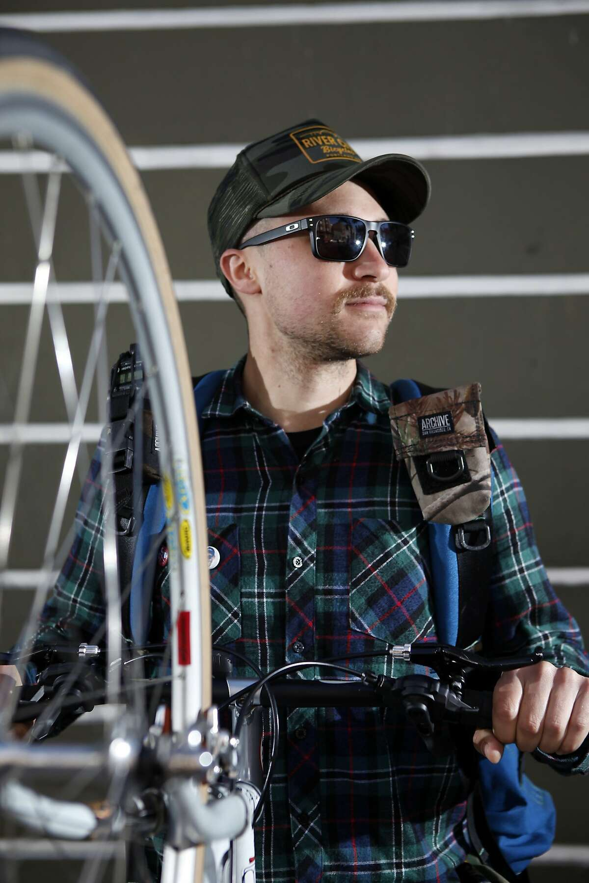 TCB Couriers' Brandon Harrison of San Francisco poses for a portrait near the company's office in San Francisco, CA, Tuesday April 22, 2014.
