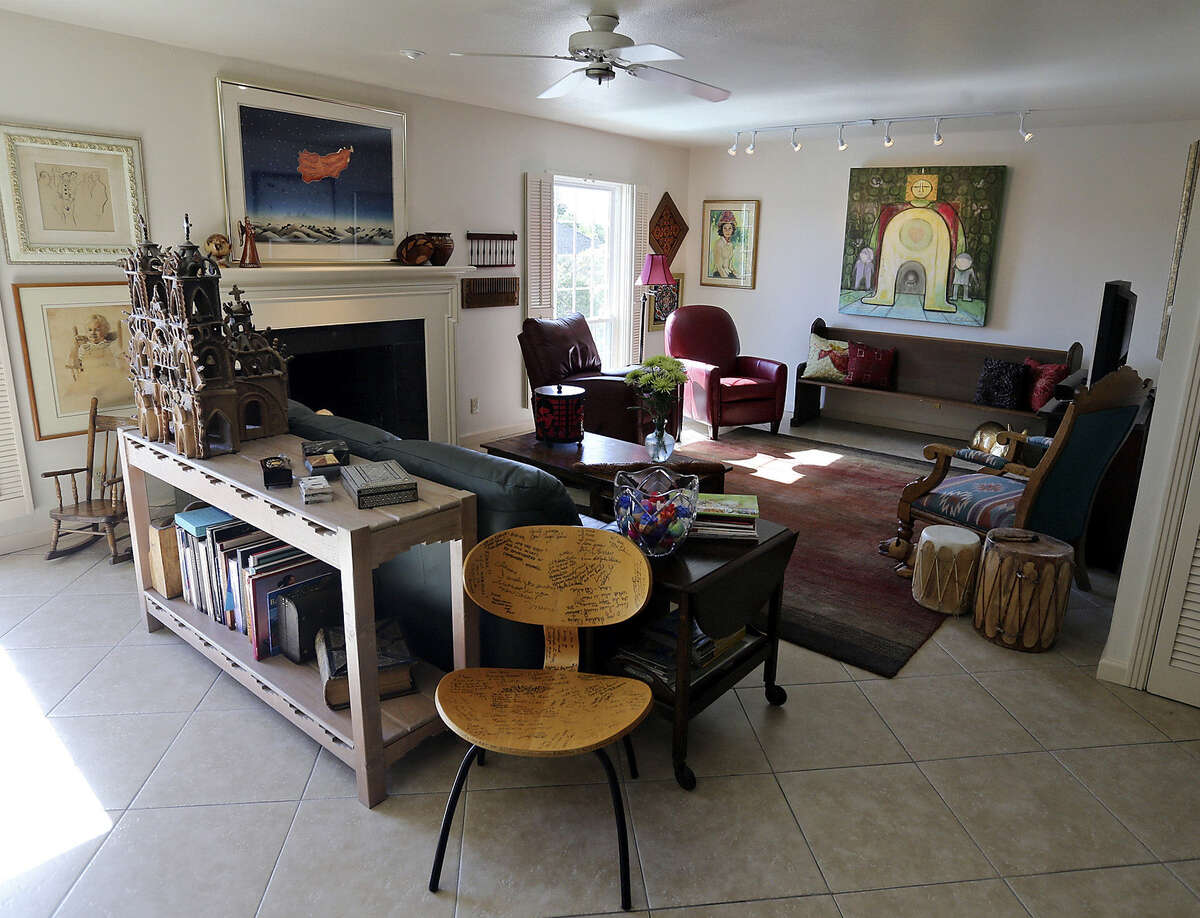 The living room in Elaine Dagen's and Michael Simpson's home is filled with works from artists such as R.C. Gorman - above the fireplace.