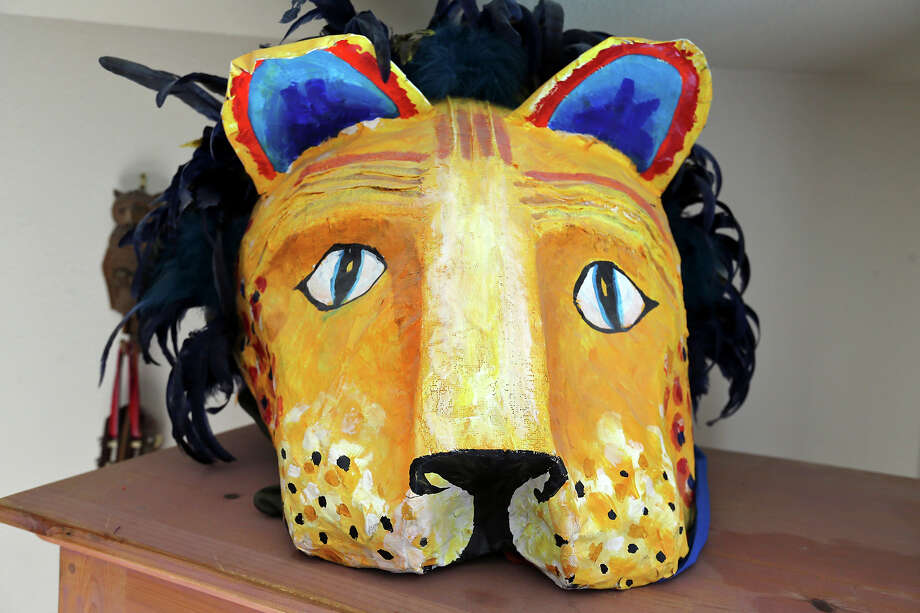 A papier-mâché head has a lion's face on the side of it. Photo: San Antonio Express-News / © 2014 San Antonio Express-News