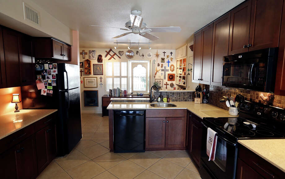 Elaine Dagen and Michael Simpson updated the kitchen in their condo, along with making changes to accommodate art throughout. Photo: San Antonio Express-News / © 2014 San Antonio Express-News