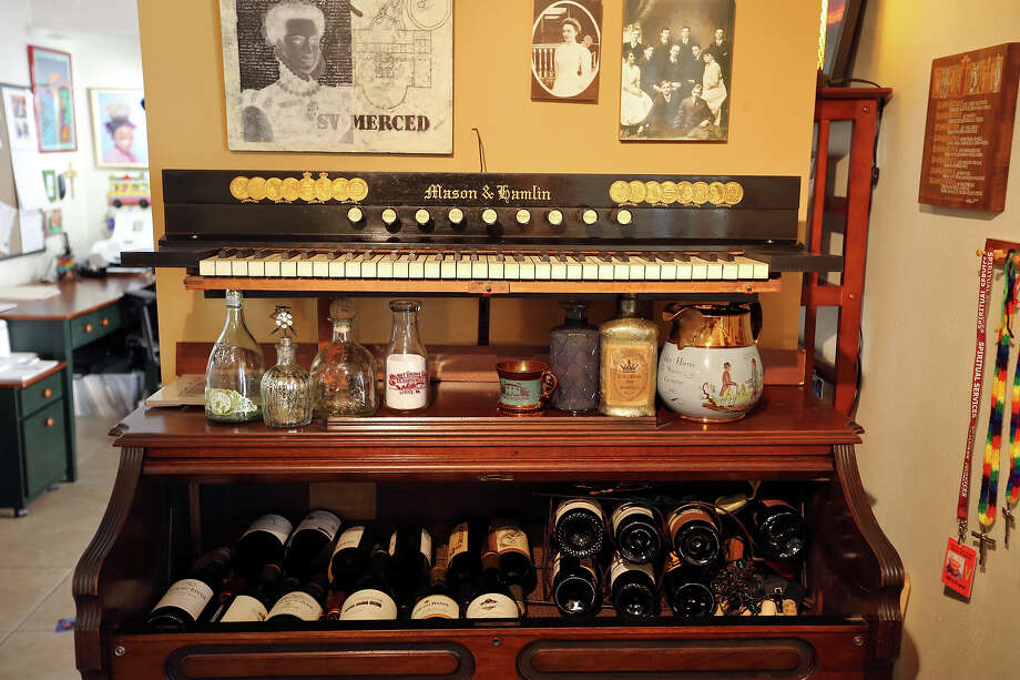 Elaine Dagen had an antique organ that belonged to her father converted into a wine cabinet. Photo: San Antonio Express-News / © 2014 San Antonio Express-News
