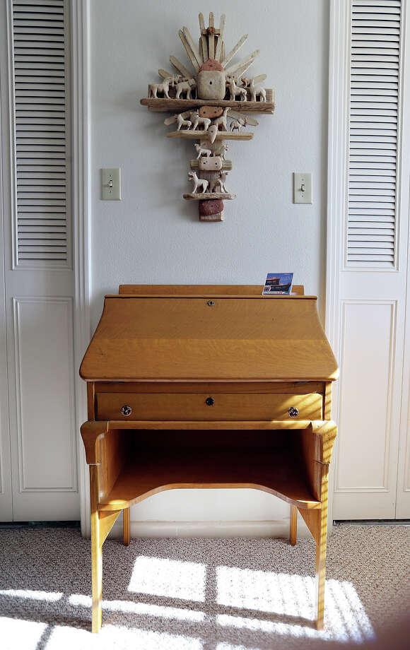 An antique desk and art in Elaine Dagen's home. Photo: San Antonio Express-News / © 2014 San Antonio Express-News