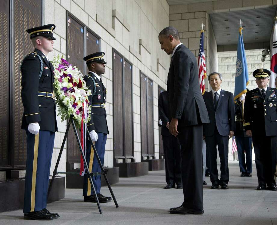 President Barack Obama pauses at the National War Memorial to honor fallen soldiers in Seoul, South Korea. Photo: Carolyn Kaster / Associated Press / AP