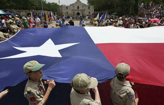 Members of the Boy Scouts of America- Alamo Area Council carry the Texas flag past the Alamo during the Battle of Flowers Parade. Photo: Edward A. Ornelas / San Antonio Express-News / © 2014 San Antonio Express-News