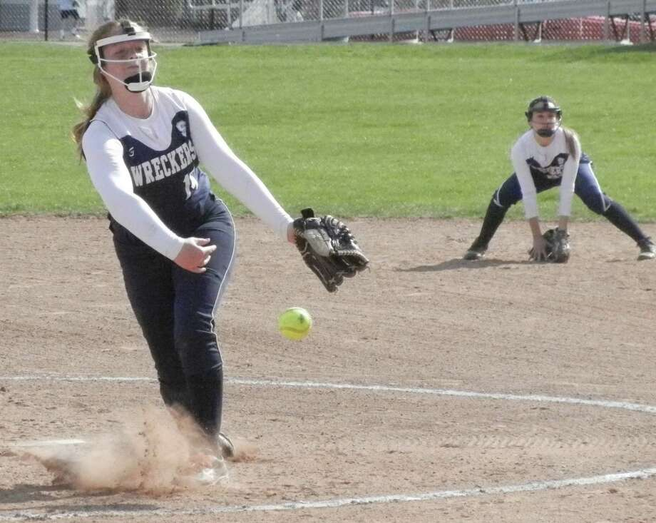 Staples freshman Gillian Birk firing to the plate in the second inning on Friday, April 25 in an FCIAC softball game at Fairfield Warde. Birk threw a no-hitter for seven innings but the host Mustangs won 1-0 on a hit by Sarah Cotto in the eighth inning. Photo: Reid L. Walmark / Fairfield Citizen