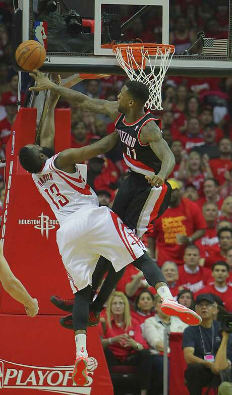 The Blazers' Thomas Robinson, right, swats a shot by the Rockets' James Harden. Photo: James Nielsen, Staff / © 2014  Houston Chronicle