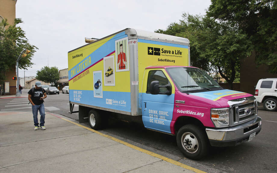 A TxDOT truck warning against driving after drinking was at Jarvis Plaza during the El Centro de Laredo Farmers Market. Photo: Victor Strife / Laredo Morning Times / LAREDO MORNING TIMES