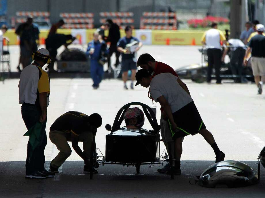 Members of Wright State University in Dayton Ohio, prepare their prototype car for a test run at Shell's Eco-Marathon Americas competition at the George R. Brown Convention center, Friday, April 25, 2014, in Houston. Photo: Karen Warren, Houston Chronicle / © 2014 Houston Chronicle