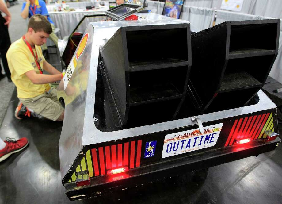 "Marcus Garner, 16, with St. Paul's School in Covington LA, works to wire the turn signals on his team's prototype  ""DeLorean""at Shell's Eco-Marathon Americas competition at the George R. Brown Convention center, Friday, April 25, 2014, in Houston. Photo: Karen Warren, Houston Chronicle / © 2014 Houston Chronicle"