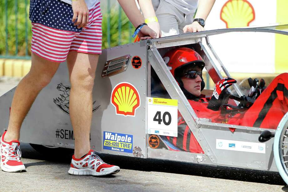 Tanner Stark, 17, of Ruston High School in Ruston, LA, gets ready to take off for a test drive in a prototype car at Shell's Eco-Marathon Americas competition at the George R. Brown Convention center, Friday, April 25, 2014, in Houston. Photo: Karen Warren, Houston Chronicle / © 2014 Houston Chronicle