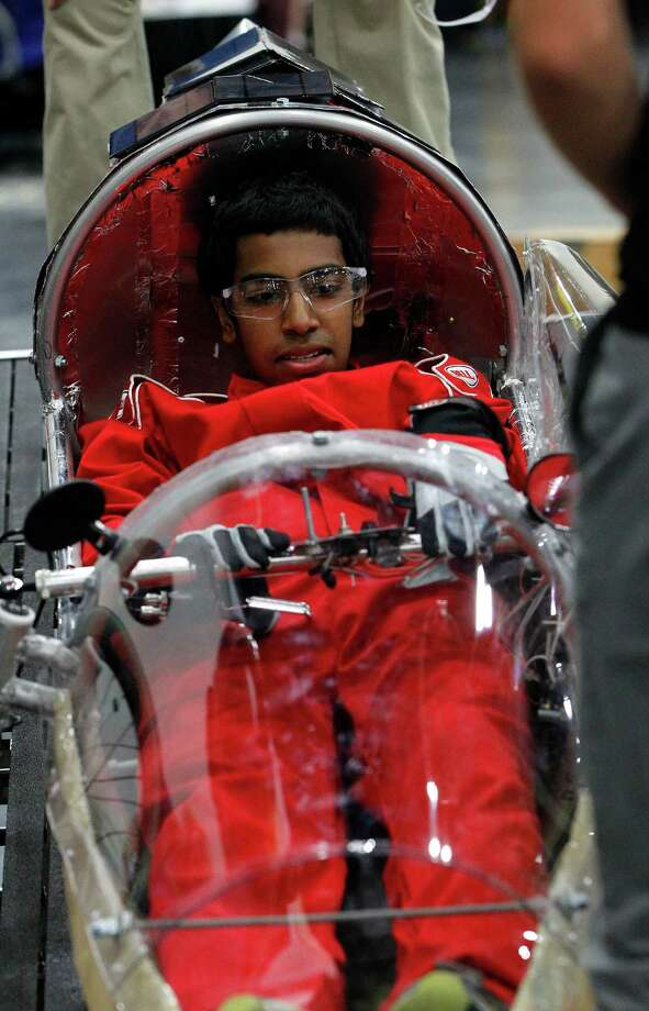 Akshay Jaggi, 17, sits in the drivers seat  of the St. John's School's prototype car at Shell's Eco-Marathon Americas competition at the George R. Brown Convention center, Friday, April 25, 2014, in Houston. Photo: Karen Warren, Houston Chronicle / © 2014 Houston Chronicle