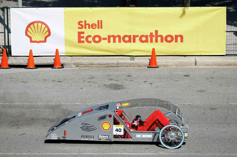 Tanner Stark, 17, of Ruston High School in Ruston, LA, takes a test drive in a prototype car at Shell's Eco-Marathon Americas competition at the George R. Brown Convention center, Friday, April 25, 2014, in Houston. Photo: Karen Warren, Houston Chronicle / © 2014 Houston Chronicle