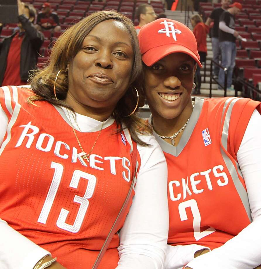 Monja Willis, left, the mother of Rockets guard James Harden and Lisa Beverley, the mother of Pat Beverley, sit on the bench before Game 3 in Portland. Photo: James Nielsen, Houston Chronicle