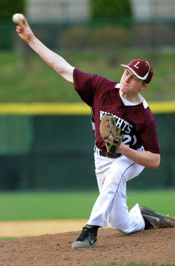 Lansingburgh's Brandon Begin releases a pitch during their baseball game against Voorheesville on Friday, April 25, 2014, at Bruno Stadium in Troy, N.Y. (Cindy Schultz / Times Union) Photo: Cindy Schultz / 00026585A