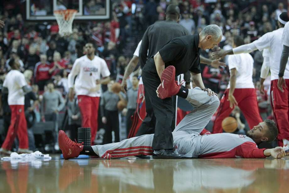 Houston's Chandler Parsons stretches before Game 3. Photo: James Nielsen, Houston Chronicle
