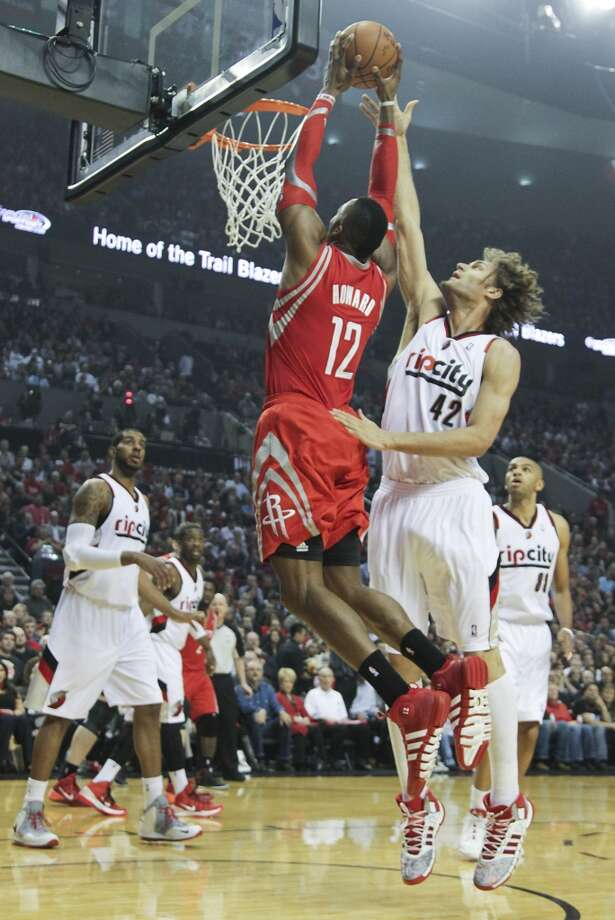 Houston's Dwight Howard drives against Portland's Robin Lopez during the first half of Game 3. Photo: James Nielsen, Houston Chronicle