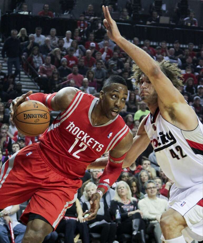Houston's Dwight Howard drives past Portland's Robin Lopez during the first half of Game 3. Photo: James Nielsen, Houston Chronicle