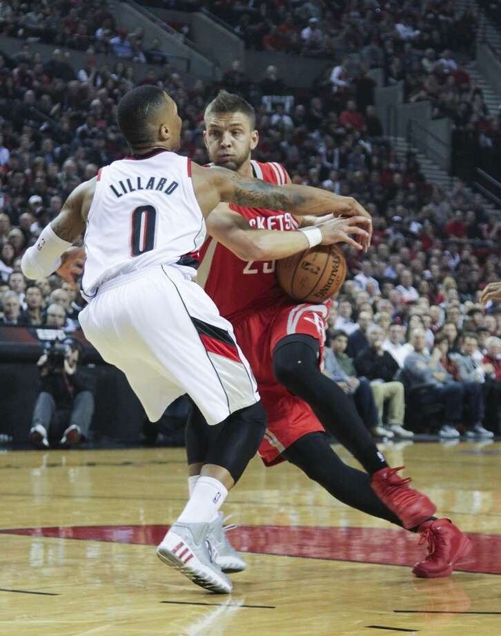 Houston's Chandler Parsons drives against Portland's Damian Lillard during the first half of Game 3. Photo: James Nielsen, Houston Chronicle