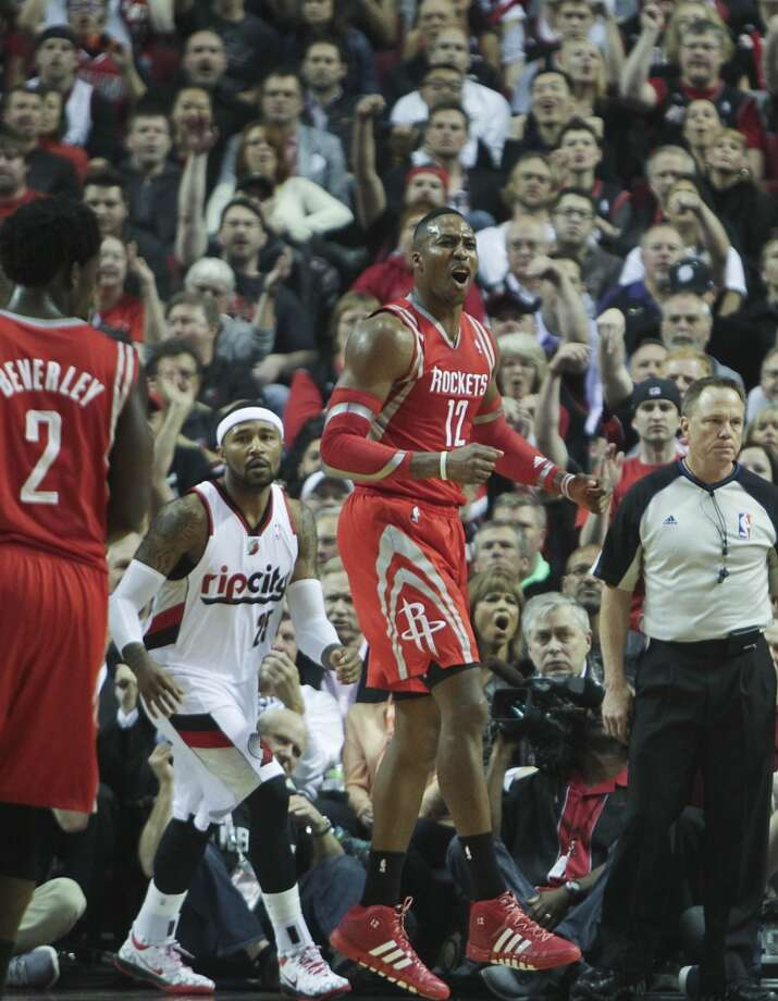Dwight Howard reacts to a call during the first half. Photo: James Nielsen, Houston Chronicle