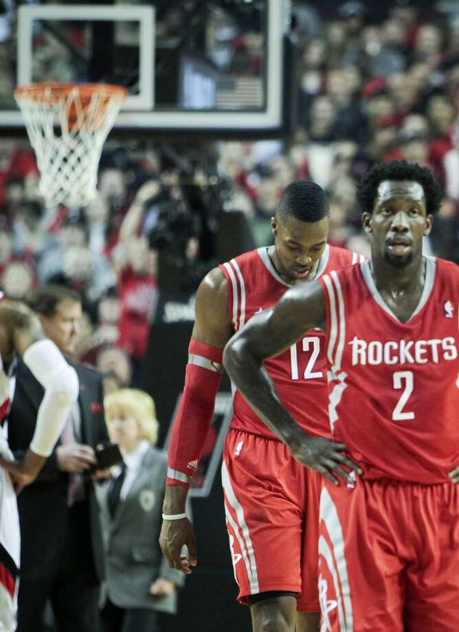 Dwight Howard and Patrick Beverley walk off the court for a timeout during the first half of Game 3. Photo: James Nielsen, Houston Chronicle