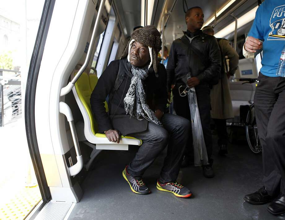 Sean Keike tries out a seat during his tour of the prototype BART car of the future on display at San Francisco's Civic Center. Photo: Michael Short, The Chronicle