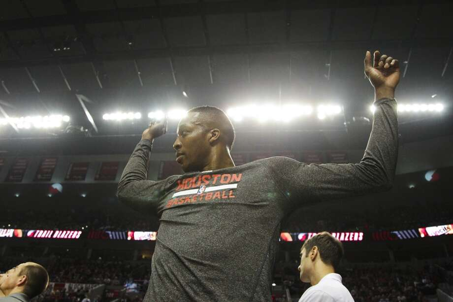 Houston's Dwight Howard stretches during the first half of Game 3. Photo: James Nielsen, Houston Chronicle