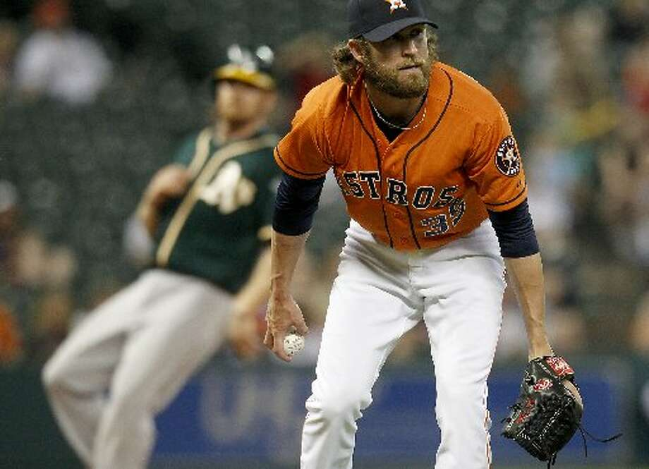 April 25: Athletics 12, Astros 5Astros relief pitcher Josh Fields (35) fields a bunt that loaded the bases in the ninth inning. Photo: Thomas B. Shea, For The Chronicle
