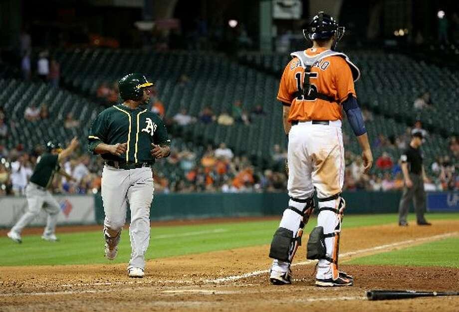 Athletics first baseman Alberto Callaspo (18) scores in the ninth inning. Photo: Thomas B. Shea, For The Chronicle