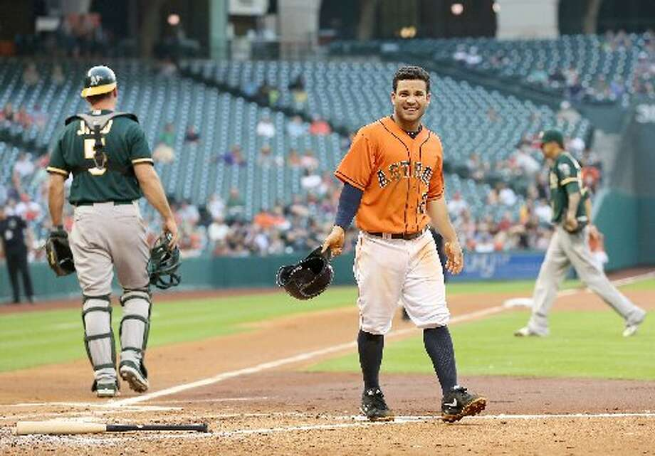 Astros second baseman Jose Altuve (27) was left on base in the bottom of the second inning. Photo: Thomas B. Shea, For The Chronicle