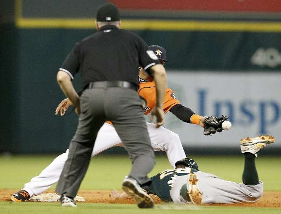 Athletics second baseman Eric Sogard (28) slides safely into second when Houston Astros shortstop Jonathan Villar (6) drops the ball in the sixth inning. Photo: Thomas B. Shea, For The Chronicle