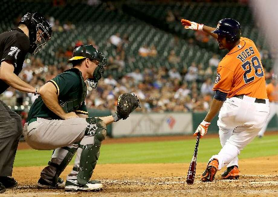 Astros pinch hitter L.J. Hoes (28) strikes put against Oakland Athletics relief pitcher Sean Doolittle (62) in the seventh inning with a man on base to end the inning. Photo: Thomas B. Shea, For The Chronicle