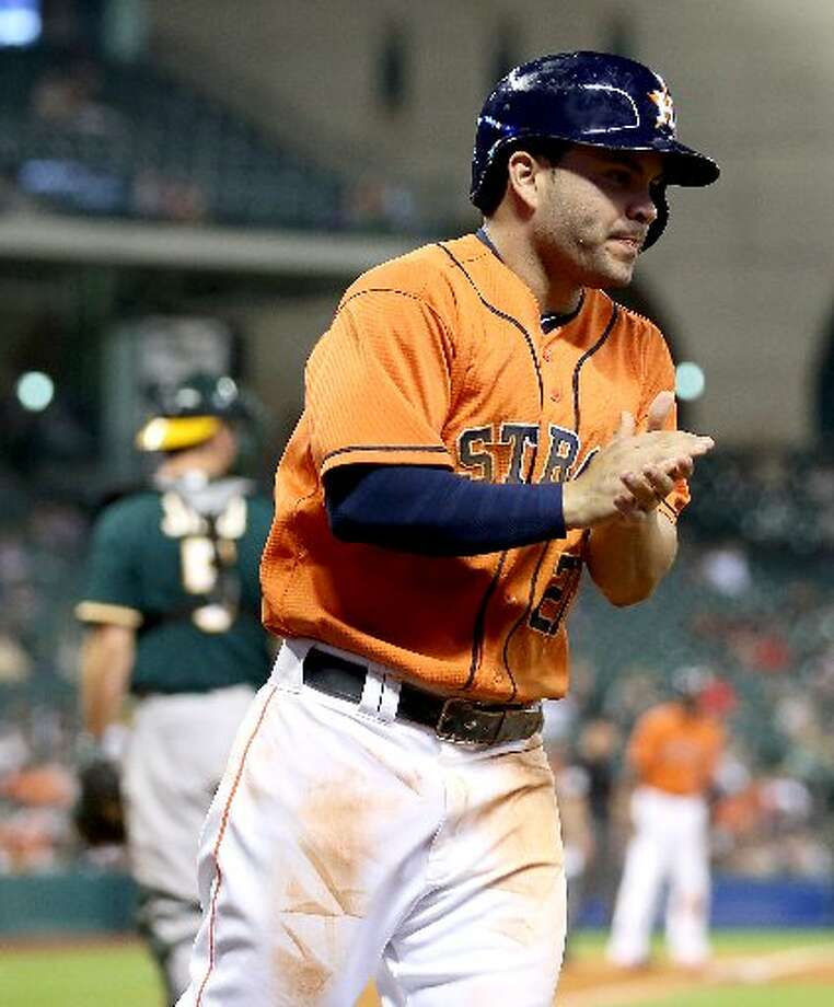 Astros second baseman Jose Altuve (27) celebrates scoring in the fourth inning. Photo: Thomas B. Shea, For The Chronicle